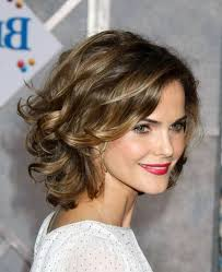 medium length haircut easy to maintain best 25 thick curly haircuts ideas on pinterest curly medium