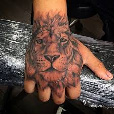 40 lion hand tattoo designs for men noble ink ideas