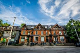 row houses on gerrard street in the garden district toronto