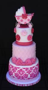 shades of pink baby shower cake with royal icing stenciling