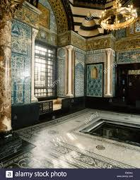 small pool and mosaic tiled walls in leighton house stock photo