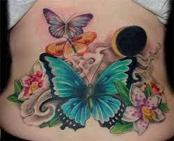 butterfly tattoos not sure what the big black blob is