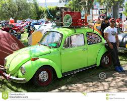 volkswagen beetle green green old volkswagen beetle car and owner at orange blossom
