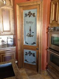corner pantry cabinets with doors and stained glass insert in fall