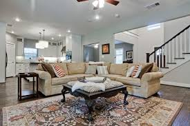 soft grey paint color and velvet sofa for traditional living room
