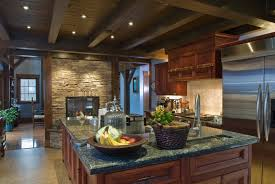 painting kitchen cabinets black round stone above the barstool