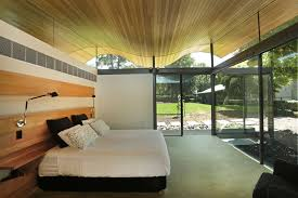 floor to ceiling glass doors a floating wavy roof sits above this australian house contemporist