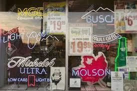 Liquor Signs Beer Signs In Neon In Liquor Store Window Of Connecticut Stock