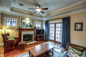 Craftsman Ceiling Fan by Craftsman Living Room With Ceiling Fan U0026 Stone Fireplace In