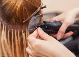 salons that do hair extensions the hairdresser does hair extensions to a girl a in