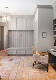Beadboard Bench - gray mudroom cabinets with beadboard trim transitional laundry