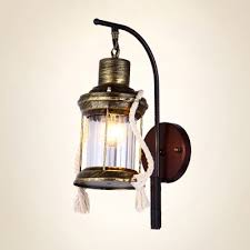 Wall Sconce Bronze Industrial Wall Sconce With Lantern Style Metal Cage And Clear