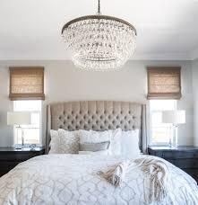chandelier bedroom master bedroom linen bed roman shades cream bedding calming
