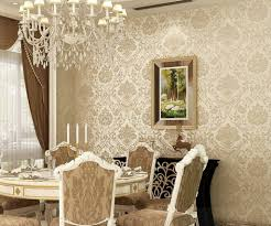 living room with black damask wallpaper and grey sofa decorate