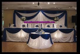 tall wedding centerpieces royal blue royal blue satin backdop
