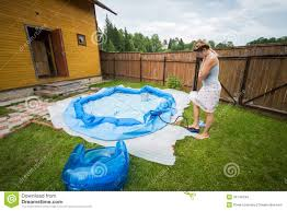 Backyard Inflatable Pool by Woman Inflates Inflatable Swimming Pool Stock Images Image 34744194