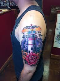 roses arm sleeve tattoo david meek tattoos traditional lighthouse and roses half sleeve