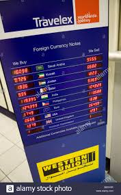 bureau change display of exchange rates at a bureau de change operated by travelex