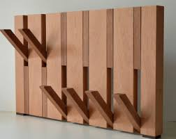 solid oak coat rack in design and fold out hooks available