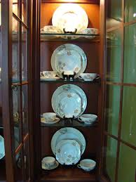 how to arrange dishes in china cabinet the of accessorizing a china cabinet matt and shari