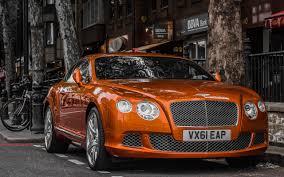 orange bentley bentley car in city street wallpapers 2560x1600 1708863