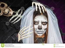 young woman a bride in a veil day of the dead mask skull face art