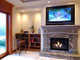 recessed lighting over fireplace are america s overexposed décor trends stereotyping our homes