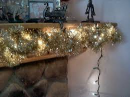 shades of safhire fireplace mantle garland and lights installing