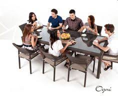 Modern Wicker Style Glass Topped Dining Table Seats  People In - Glass top dining table montreal