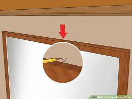 How To Hang A Bathroom Mirror by How To Hang A Heavy Mirror With Pictures Wikihow