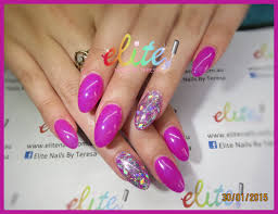bright pink and diamond shaped glitter sparkle bling nails nail
