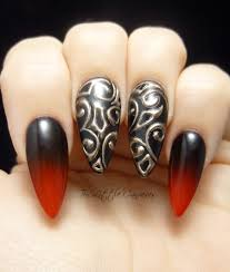 black and gold black and red ombre stiletto vampire nails