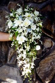 wedding flowers valley of the valley dominate this open end cascade bouquet of white