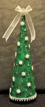 cone christmas tree with recycled wine bottle base cover with