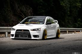 mitsubishi lancer stance evo x with fender flares and a wide stance by avant garde u2014 carid