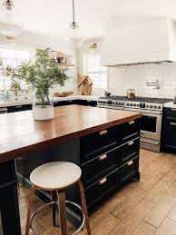 top of kitchen cabinet greenery all the faux plants all our home chris