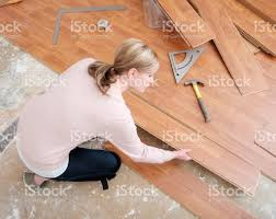 Laminate Flooring Installation Tools Woman Installing Laminate Flooring Stock Photo 480131418 Istock