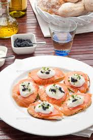 traditional canapes salmon canapes with traditional caviar stock photo by vpardi
