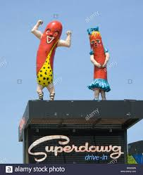 dog people on the roof of superdawg in chicago illinois stock