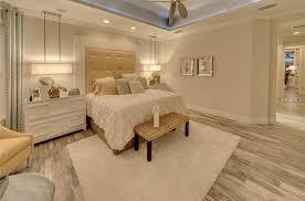 floor master bedroom contemporary master bedroom with pendant light ceiling fan in
