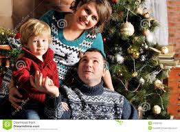 portrait of a friendly family with pregnant woman during christmas