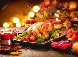 thanksgiving dinner table served with turkey decorated with stock