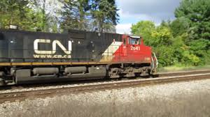 box car train cn 2641 2804 2341 heading east with a manifest train through