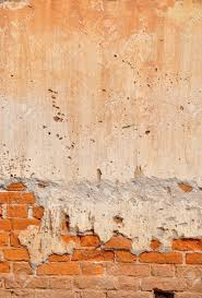 red clay stained on the white exposed brick concrete wall stock