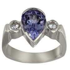tanzanite stone rings images Tanzanite stone pear shaped engagement ring with bezel set jpg