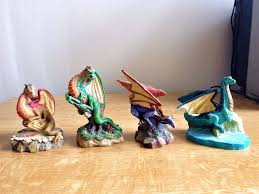 set of 4 tudor mint land of the dragons collectable miniatures