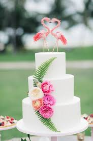 plain wedding cakes picture of a plain white cake decorated with flowers and leaves