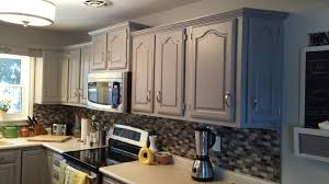 white kitchen cabinets with cathedral doors image result for white painted cathedral oak cabinets oak