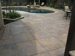 floor swimming pool design ideas with stamp concrete also green