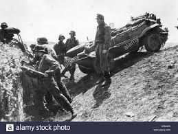 volkswagen schwimmwagen for sale soldiers of the waffen ss with a vw schwimmwagen 1943 stock photo